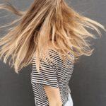 woman wearing black and white stripe blouse
